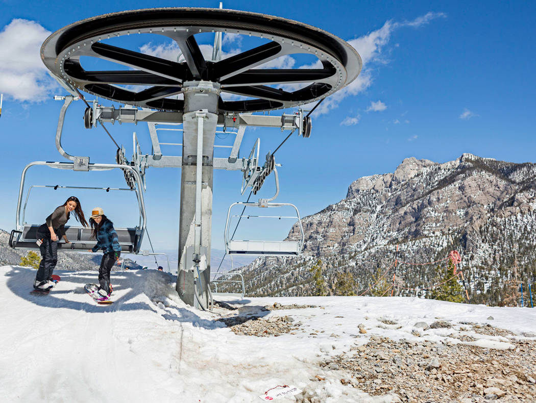 Snowboarders Jasmine Solomon, left, and Candyss Passarelli, get off the lift at Lee Canyon to go down the slope on the final day of the 2016-17 season, in Las Vegas, Sunday, April 2, 2017. (Elizab ...