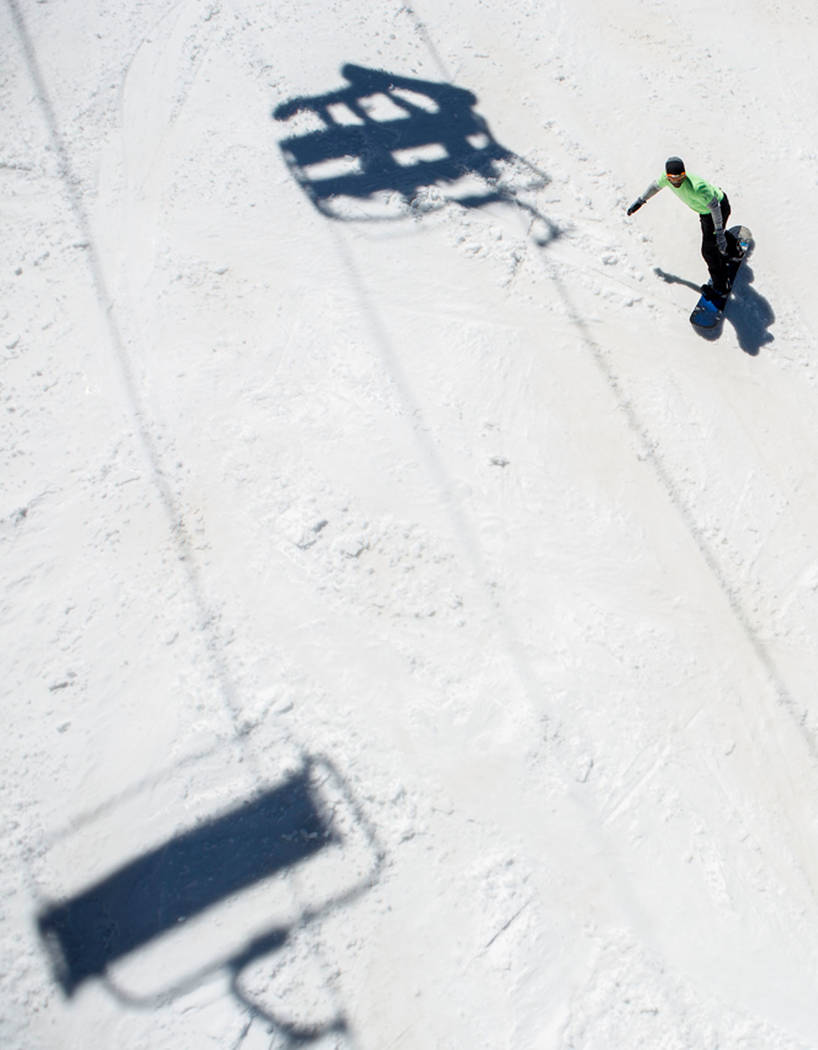 A snowboarder rides down a slope at Lee Canyon on the final day of the 2016-17 season, in Las Vegas, Sunday, April 2, 2017. (Elizabeth Brumley/Las Vegas Review-Journal) @EliPagePhoto