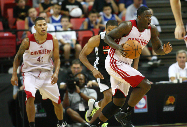 Cleveland's Anthony Bennett, right, drives the ball against Houston as teammate Steven Gray (41) looks on during an NBA Summer League game at the Thomas & Mack Center in Las Vegas on Thursday, ...