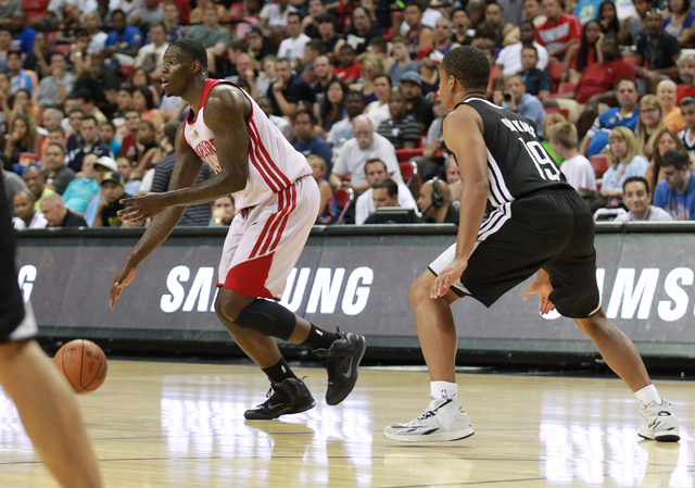 Cleveland's Anthony Bennett (15) drives the ball past Houston's Andre Dawkins (19) defends during an NBA Summer League game at the Thomas & Mack Center in Las Vegas on Thursday, July 17, 2014. ...