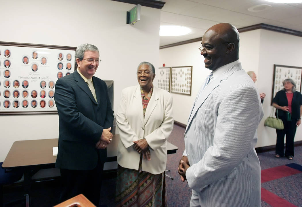 The Senate delegation from right to left, Sen. Maurice Washington, R-Sparks, Sen. Bernice Mathews, D-Sparks, and Sen. Mike McGinness, R-Las Vegas, wait to enter the Assembly Chambers on Friday, Ju ...
