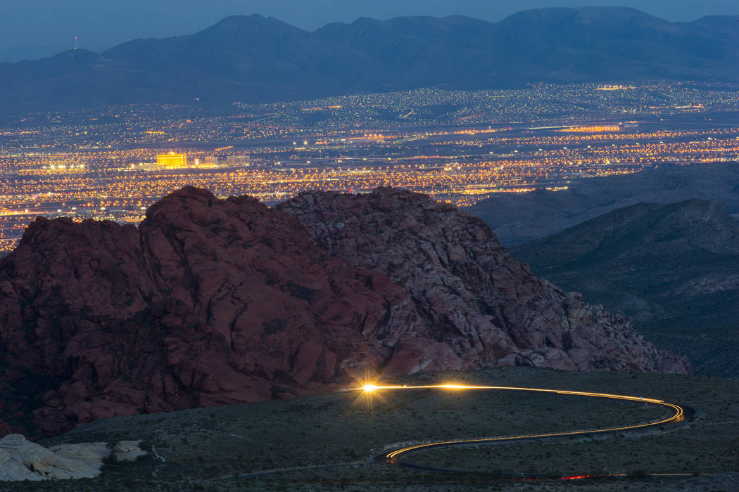 Cars drive along the 13-mile scenic drive at Red Rock Canyon National Conservation Area outside Las Vegas on Wednesday, March 29, 2017. (Chase Stevens/Las Vegas Review-Journal) @csstevensphoto
