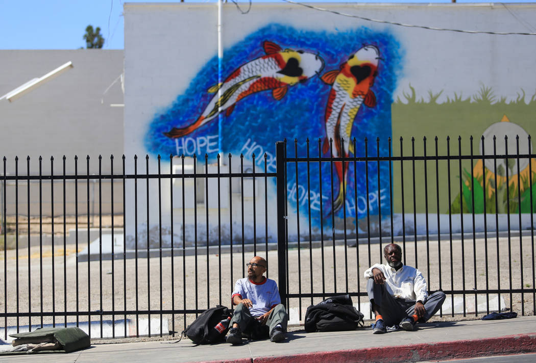 Joseph McCallen, left, and Ricky Triplett sit on Foremaster Lane in Las Vegas, on Friday, April 28, 2017, in front of land that the city of Las Vegas wants to turn into a campus that will bring ho ...