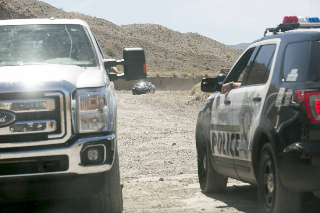 Metro officers block an entrance to Eagle Wash Road, that leads to a crime scene, at Lake Mead National Recreation Area on Tuesday, May 2, 2017. Bridget Bennett Las Vegas Review-Journal @bridgetkb ...