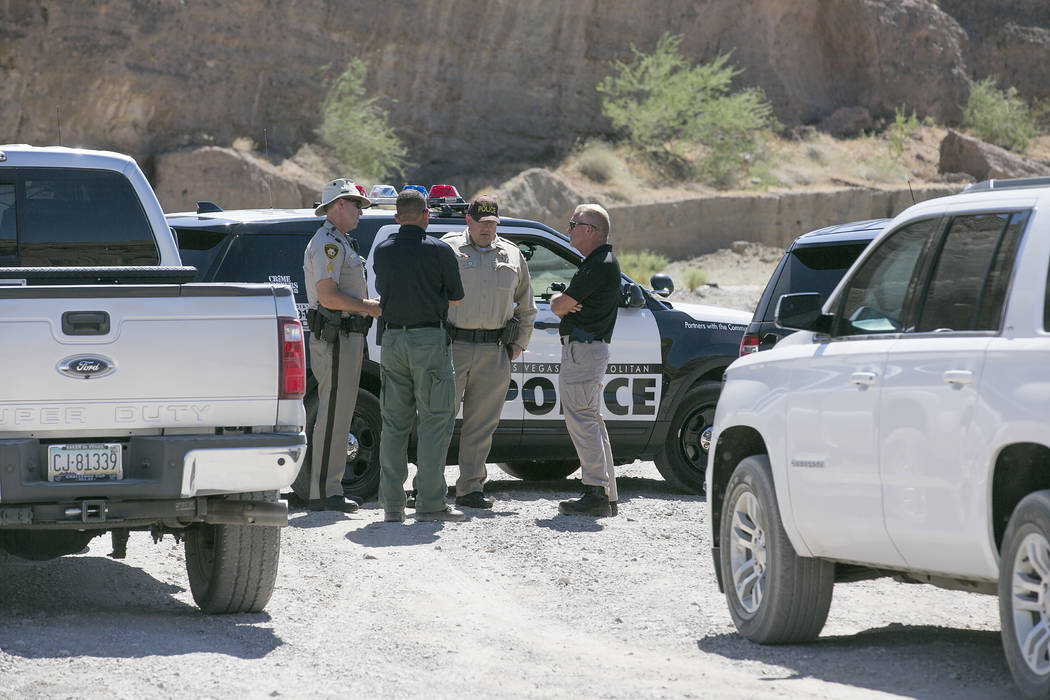 Officers talk an entrance to Eagle Wash Road, which leads to the crime scene, at Lake Mead National Recreation Area on Tuesday, May 2, 2017. Bridget Bennett Las Vegas Review-Journal @bridgetkbennett
