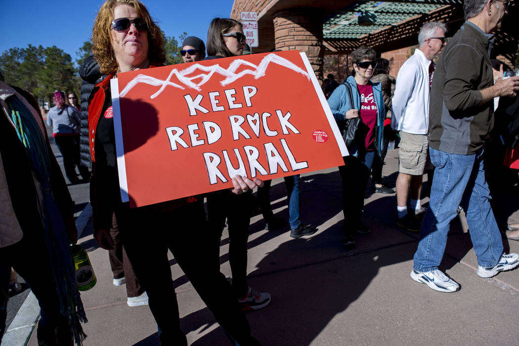 Susan Nicaise, a supporter of Save Red Rock, holds a sign to protest the proposed development of 5,025 homes on Blue Diamond Hill at a press conference before the County Commissioners meeting, Wed ...