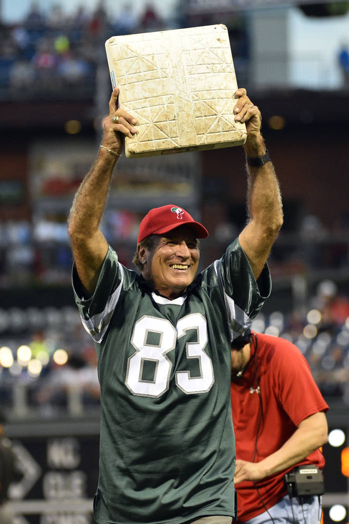 Former Philadelphia Eagle Vince Papale waves to the crowd after changing a base during a baseball game between the Philadelphia Phillies and the Milwaukee Brewers, Friday, June 3, 2016, in Philade ...