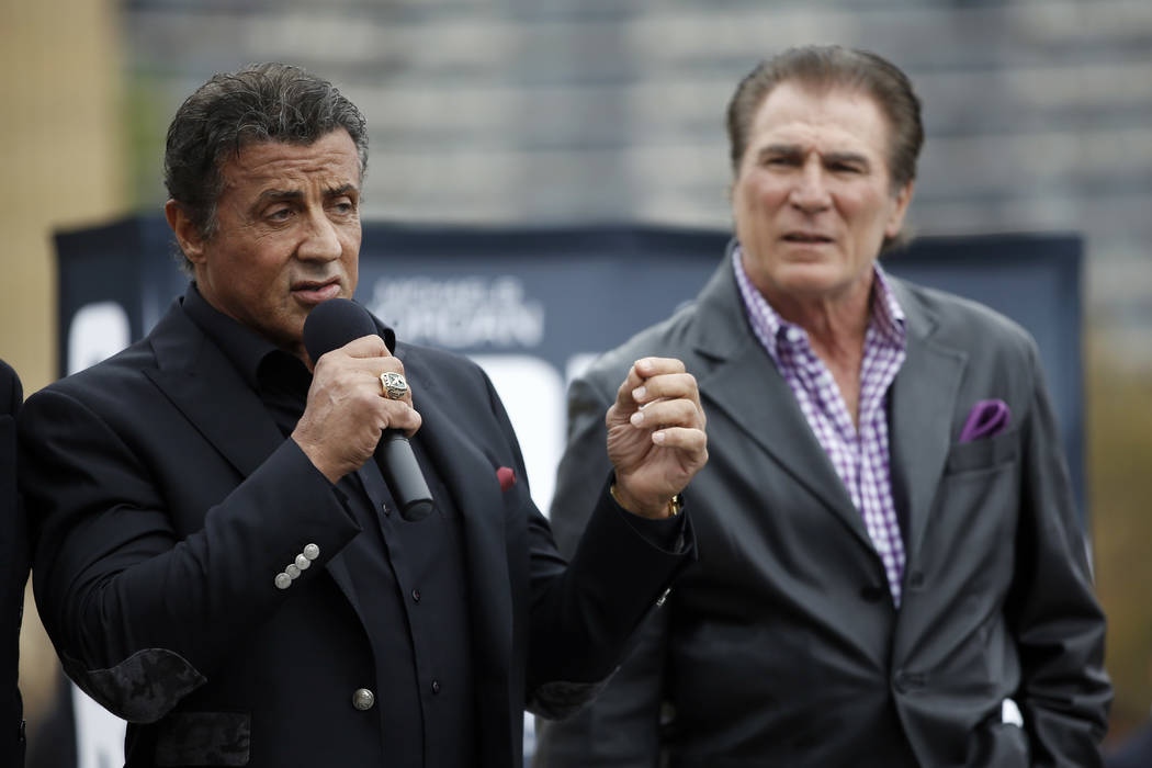 "Actor Sylvester Stallone, left, speaks during a press conference promoting the film ""Creed"" as Philadelphia Eagles football legend Vince Papale looks on outside the Philadelphia  ..."