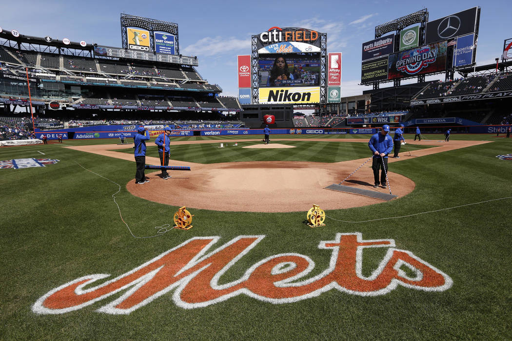 The grounds crew prepares the field before an opening day baseball game at Citi Field between the New York Mets and the Atlanta Braves, Monday, April 3, 2017, in New York. (AP Photo/Seth Wenig)