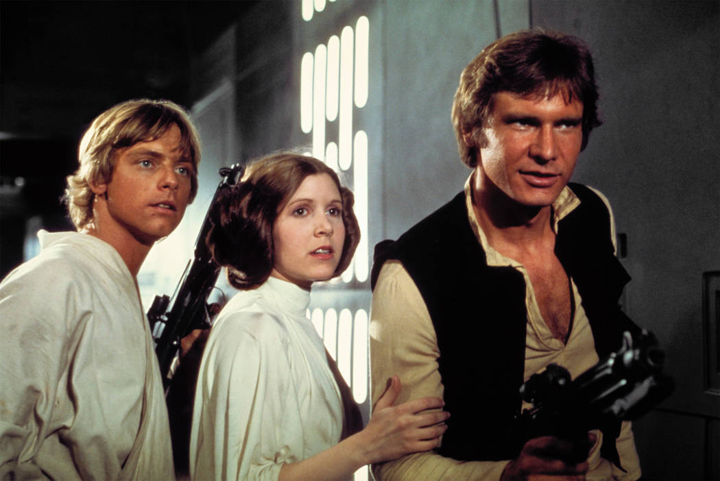 "Mark Hamill as Luke Skywalker, Carrie Fisher as Princess Leia and Harrison Ford as Han Solo escape from the Death Star in ""Star Wars: Episode IV A New Hope."""