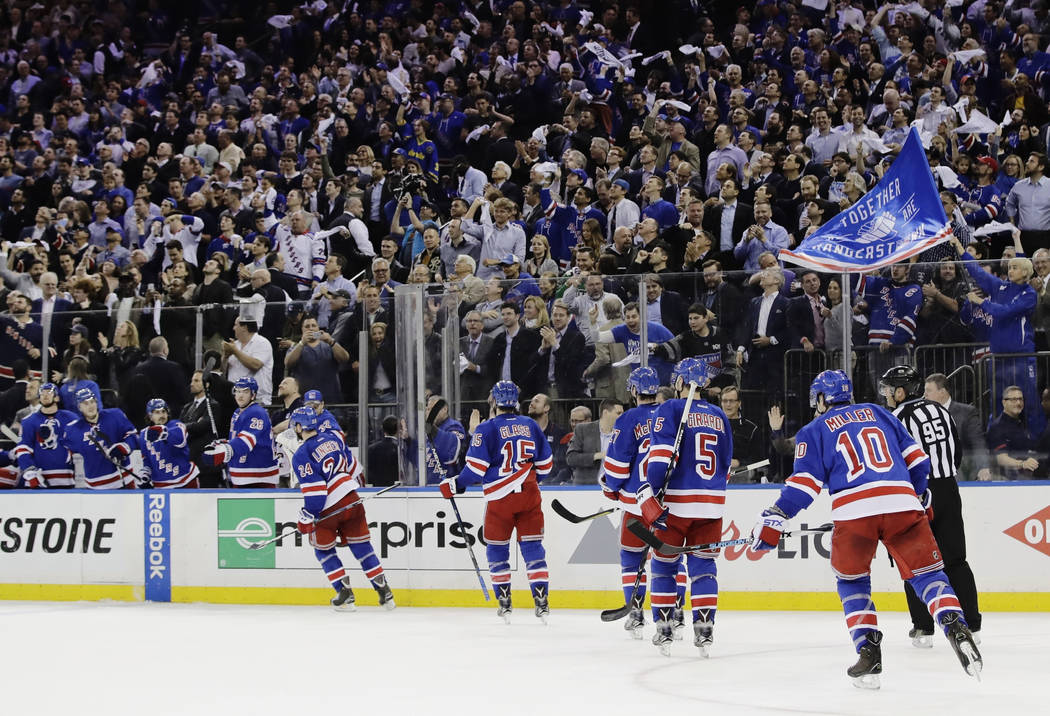 Fans celebrate after New York Rangers' Oscar Lindberg (24) scored a goal during the second period of Game 3 of the team's NHL hockey Stanley Cup second-round playoff series against the Ottawa Sena ...