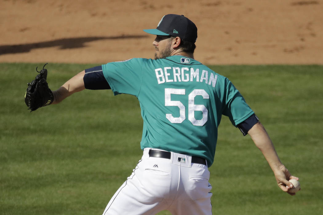 Seattle Mariners pitcher Christian Bergman throws during the fifth inning of a spring training baseball game against the San Diego Padres Sunday, Feb. 26, 2017, in Peoria, Ariz. (AP Photo/Charlie  ...
