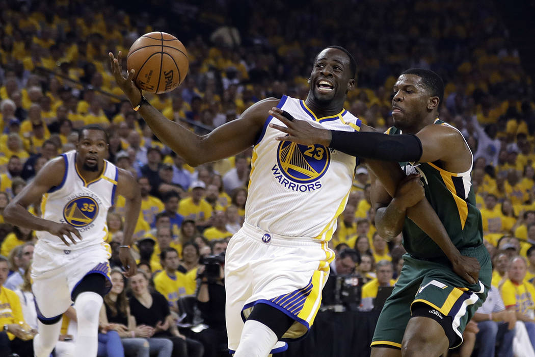 Golden State Warriors forward Draymond Green (23) is fouled by Utah Jazz forward Joe Johnson, right, during the first half in Game 1 of an NBA basketball second-round playoff series, Tuesday, May  ...