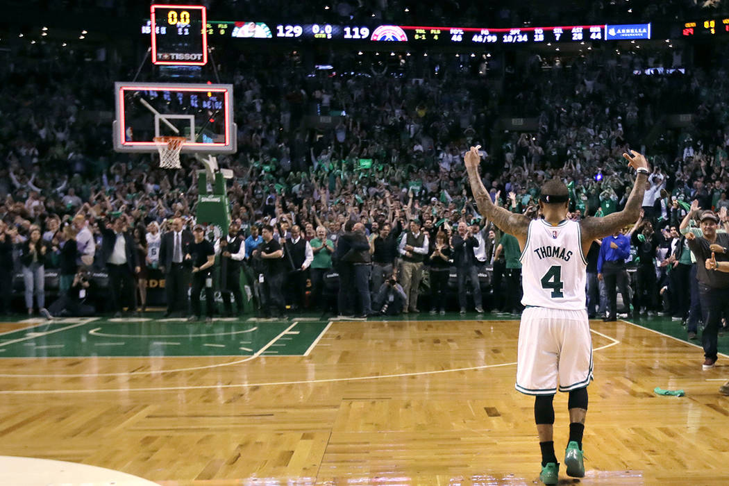 Boston Celtics guard Isaiah Thomas celebrates with fans after defeating the Washington Wizards 129-119 in a second-round NBA playoff series basketball game in Boston, Tuesday, May 2, 2017. Thomas  ...