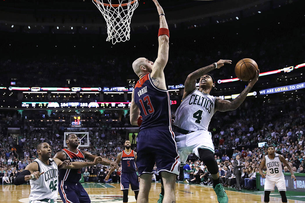 Boston Celtics guard Isaiah Thomas (4) shoots over Washington Wizards center Marcin Gortat (13) during the second half of a second-round NBA playoff series basketball game in Boston, Tuesday, May  ...