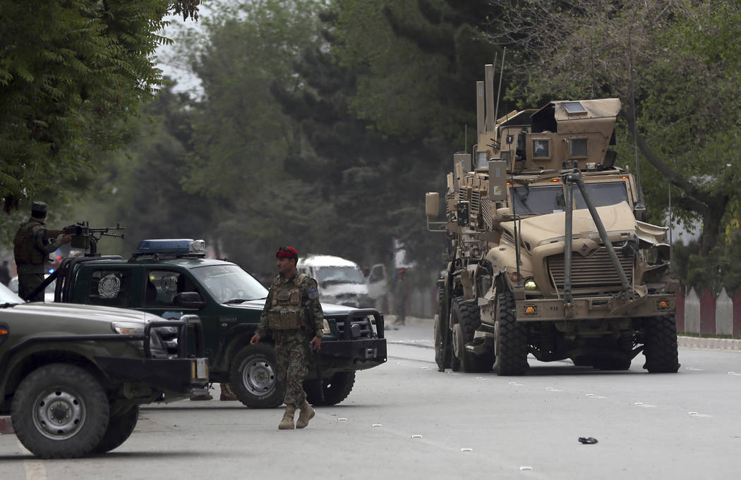A damaged US military vehicle is being pulled near the site of a suicide attack in Kabul, Afghanistan, Wednesday, May 3 , 2017. Afghan officials say that at least four people have been killed in a ...