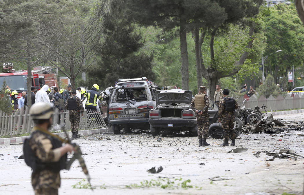 Security forces inspect at the site of a suicide attack in Kabul, Afghanistan, Wednesday, May 3 , 2017.  Afghan officials say that at least four people have been killed in a suicide car bomb attac ...