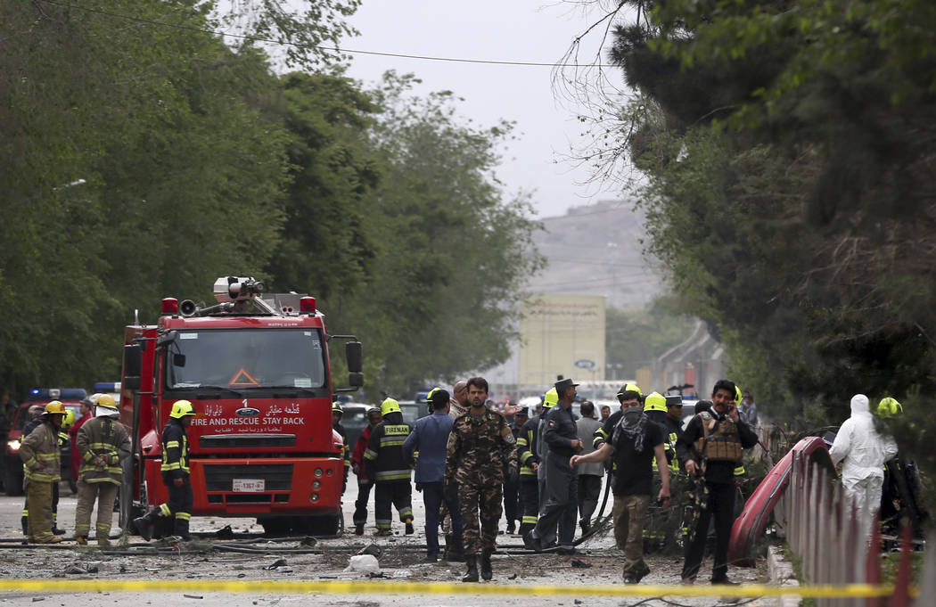 Security forces inspect at the site of a suicide attack in Kabul, Afghanistan, Wednesday, May 3 , 2017.  Najib Danish, deputy spokesman for the Interior Ministry, said Wednesday the target of the  ...