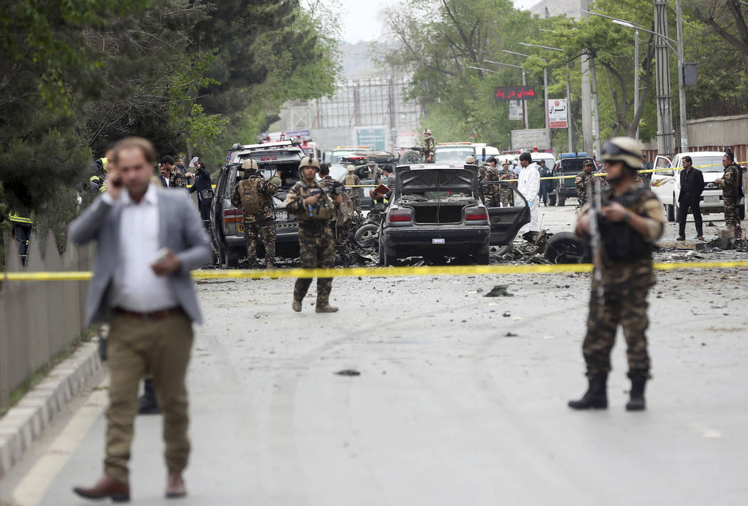 Security forces inspect the site of a suicide attack in Kabul, Afghanistan, Wednesday, May 3 , 2017. Najib Danish, deputy spokesman for the Interior Ministry, said Wednesday the target of the bomb ...