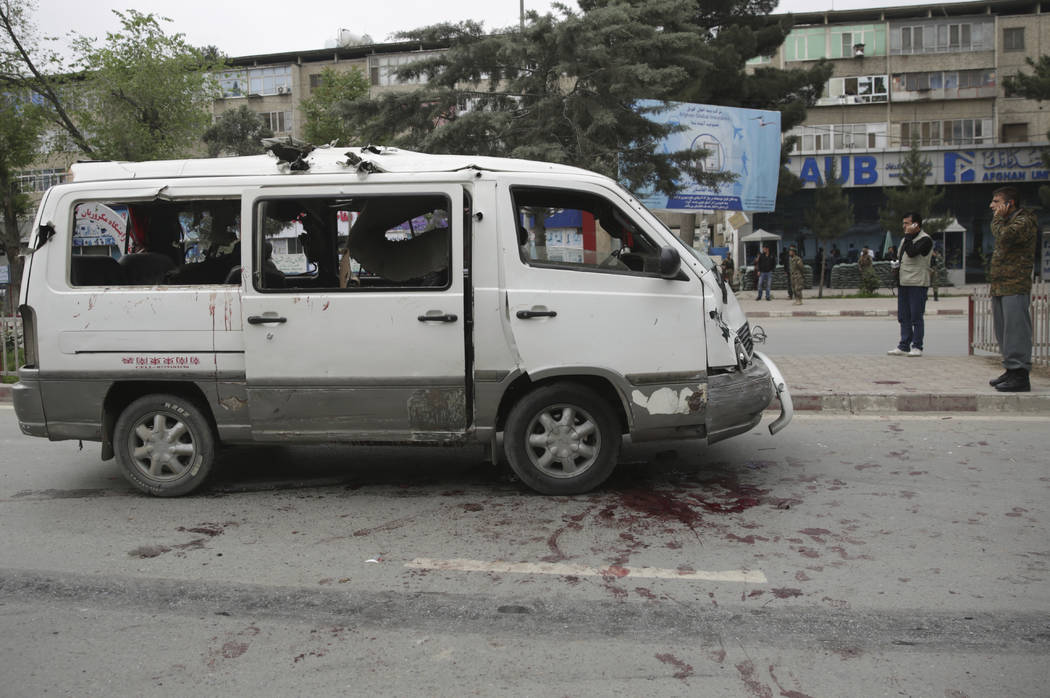 A civilian vehicle is seen at the site of a suicide attack in Kabul, Afghanistan, Wednesday, May 3 , 2017. Najib Danish, deputy spokesman for the Interior Ministry, said Wednesday the target of th ...