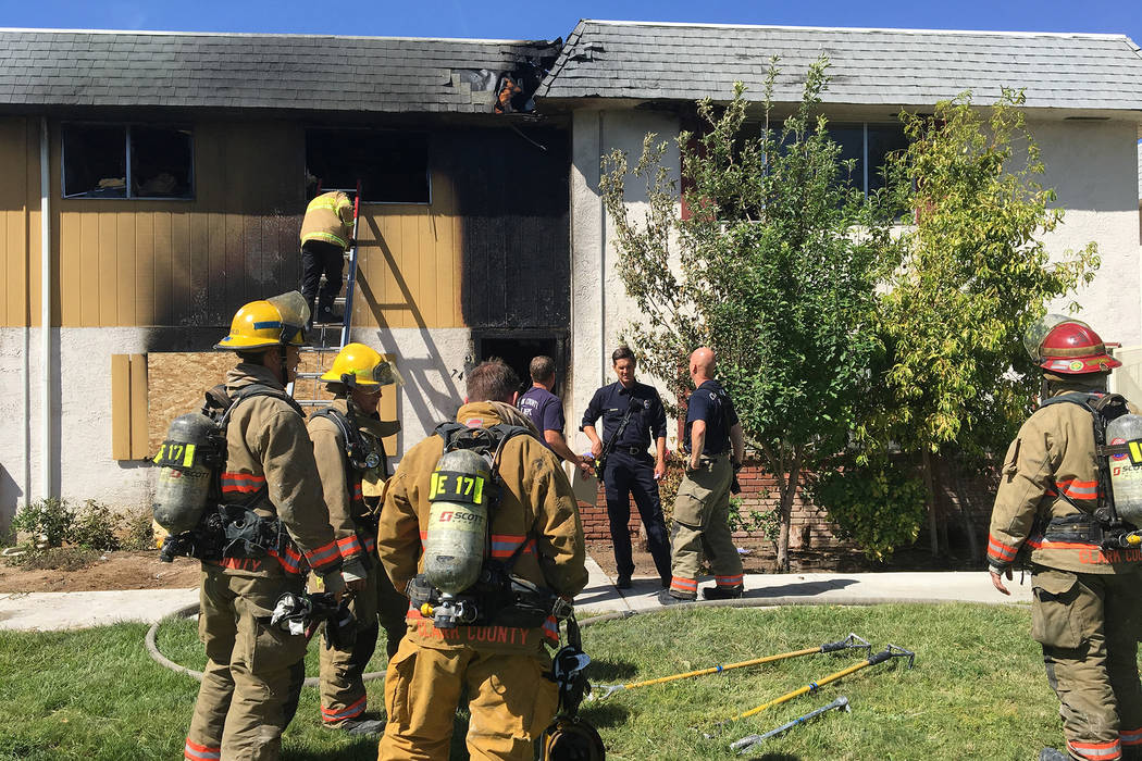 Clark County firefighters respond to a blaze at 741 and 743 Greenbriar Townhouse Way in Las Vegas on Wednesday, May 3, 2017. Bizuayehu Tesfaye/Las Vegas Review-Journal @bizutesfaye