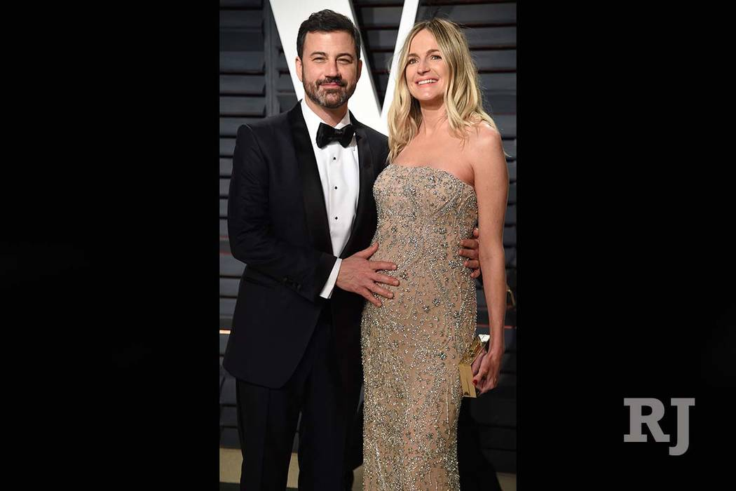This Feb. 27, 2017, file photo shows Jimmy Kimmel and his pregnant wife, Molly McNearney, at the Vanity Fair Oscar Party in Beverly Hills, California. Evan Agostini/Invision/AP