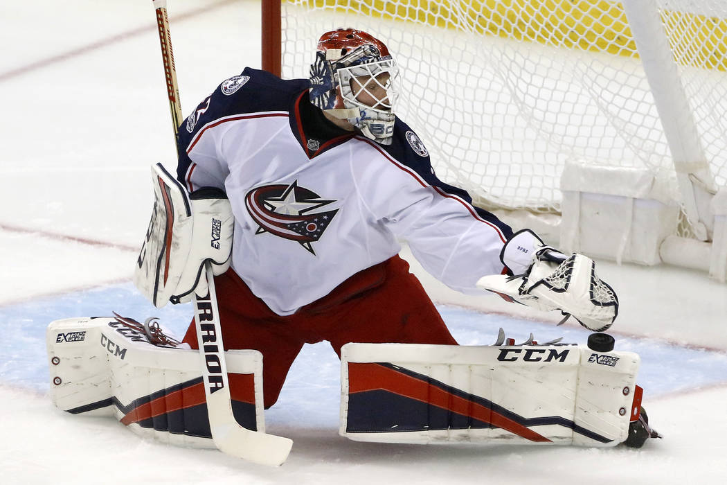Columbus Blue Jackets goalie Sergei Bobrovsky blocks a shot during the first period in Game 5 of the team's NHL first-round hockey playoff series against the Pittsburgh Penguins in Pittsburgh, Thu ...
