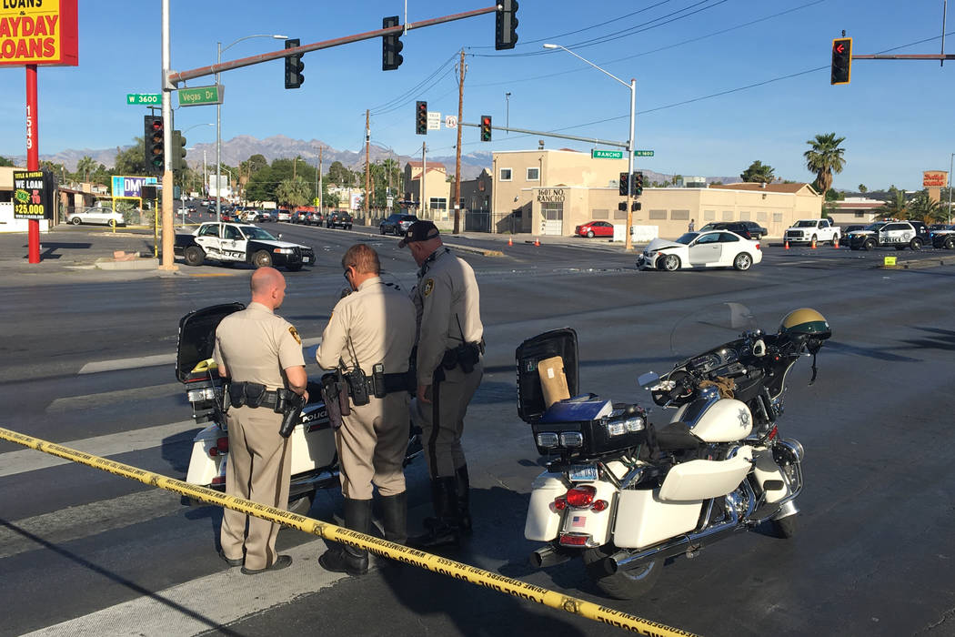 Las Vegas police at the scene of a crash at Rancho and Vegas drives where one officer was taken to the hospital on Wednesday, May 3, 2017. Bizuayehu Tesfaye/Las Vegas Review-Journal @bizutesfaye