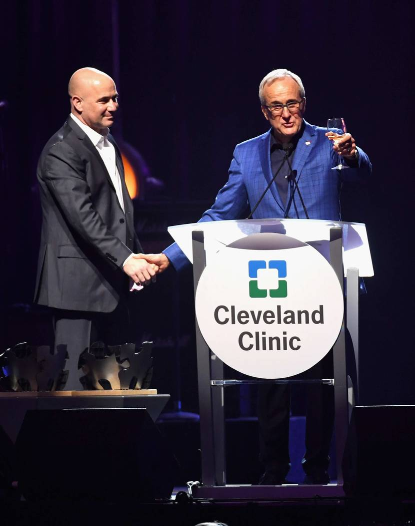 "Andre Agassi accepts the Community Achievement Award from Keep Memory Alive co-founder and Chairman Larry Ruvo during the Keep Memory Alive ""Power of Love Gala"" at MGM Grand Garden Arena on Thursd ..."