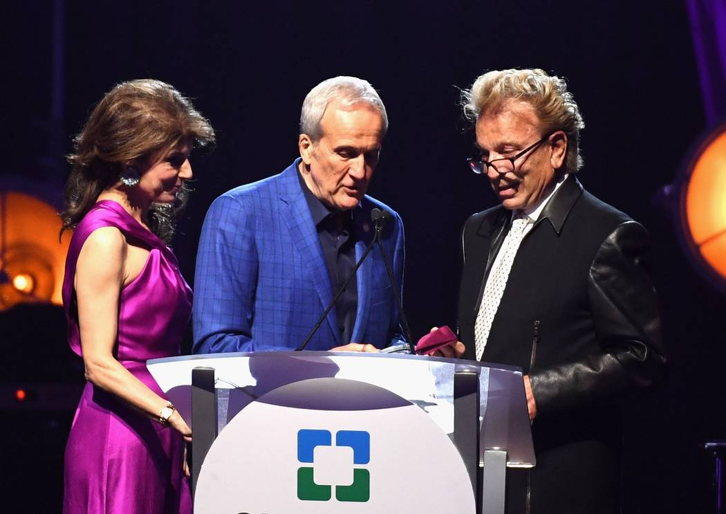 Keep Memory Alive co-founder and Vice Chairwoman Camille Ruvo and Keep Memory Alive co-founder and Chairman Larry Ruvo award Siegfried Fischbacher the inaugural Caregiver Award during the Keep Mem ...
