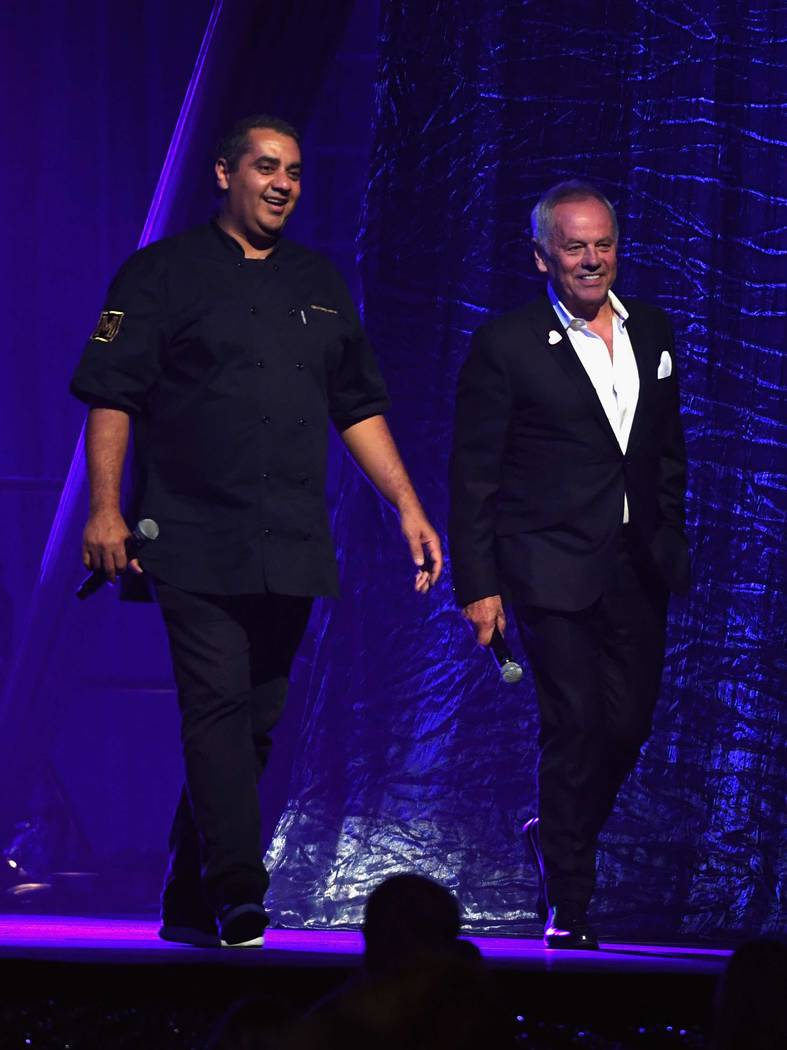 "Chefs Michael Mina and Wolfgang Puck participate in a live auction during the Keep Memory Alive ""Power of Love Gala"" at MGM Grand Garden Arena on Thursday, April 27, 2017, in Las Vegas. (Ethan Mil ..."