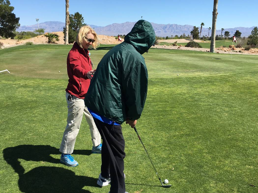 Catherine Daruwalla, a Summerlin Hospital physical therapist, assists a stroke survivor April 21, 2017 at Angel Park Golf Course. The Strokes For Strokes Las Vegas program saw roughly 50 participa ...