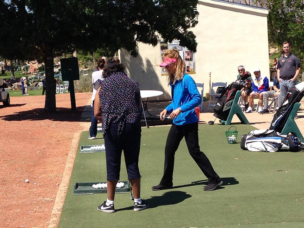 Nicole Dutt-Roberts, a PGA pro, in blue, instructs a stroke victim April 21, 2017 at Angel Park Gold Course.  About 50 people who had had strokes were at the Las Vegas course to try their hand at  ...