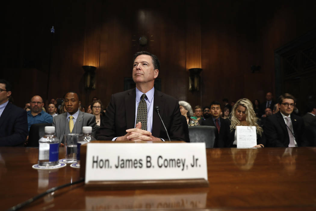 "FBI Director James Comey prepares to testify on Capitol Hill in Washington, Wednesday, May 3, 2017, before the Senate Judiciary Committee hearing: ""Oversight of the Federal Bureau of Investigation ..."