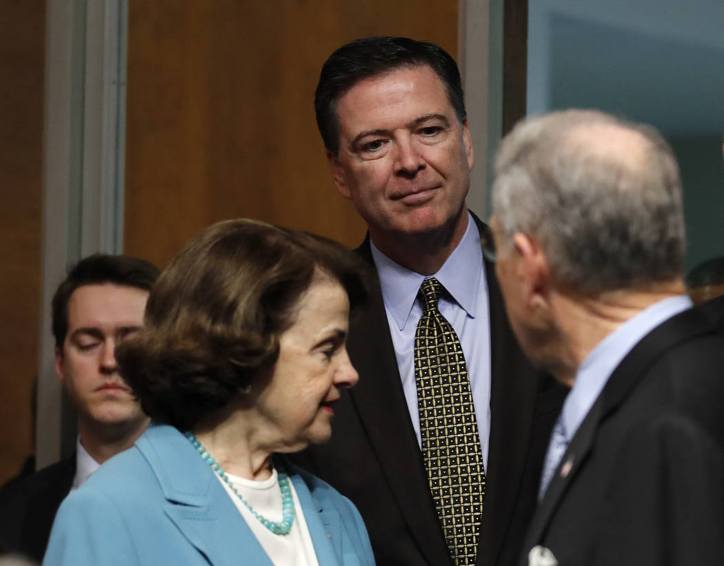 FBI Director James Comey, flanked by Senate Judiciary Committee Chairman Sen. Charles Grassley, R-Iowa, right, and the committee's ranking member Sen. Dianne Feinstein, D-Calif., arrives on Capito ...