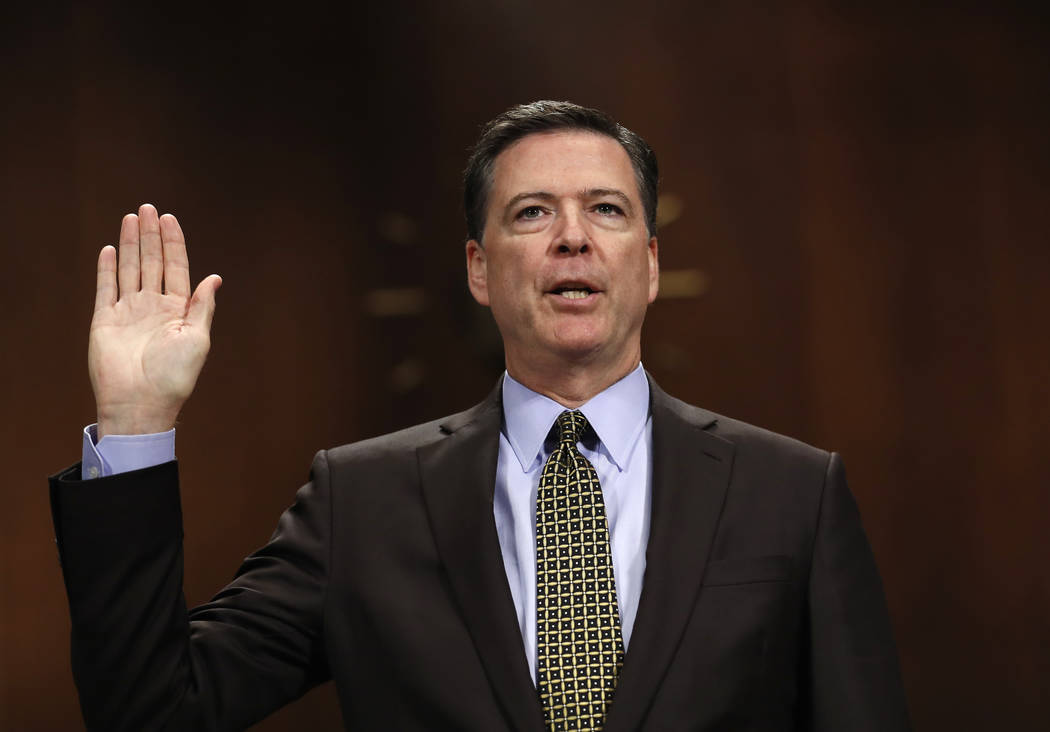 "FBI Director James Comey is sworn-in on Capitol Hill in Washington, Wednesday, May 3, 2017, prior to testifying before the Senate Judiciary Committee hearing: ""Oversight of the Federal Bureau of I ..."