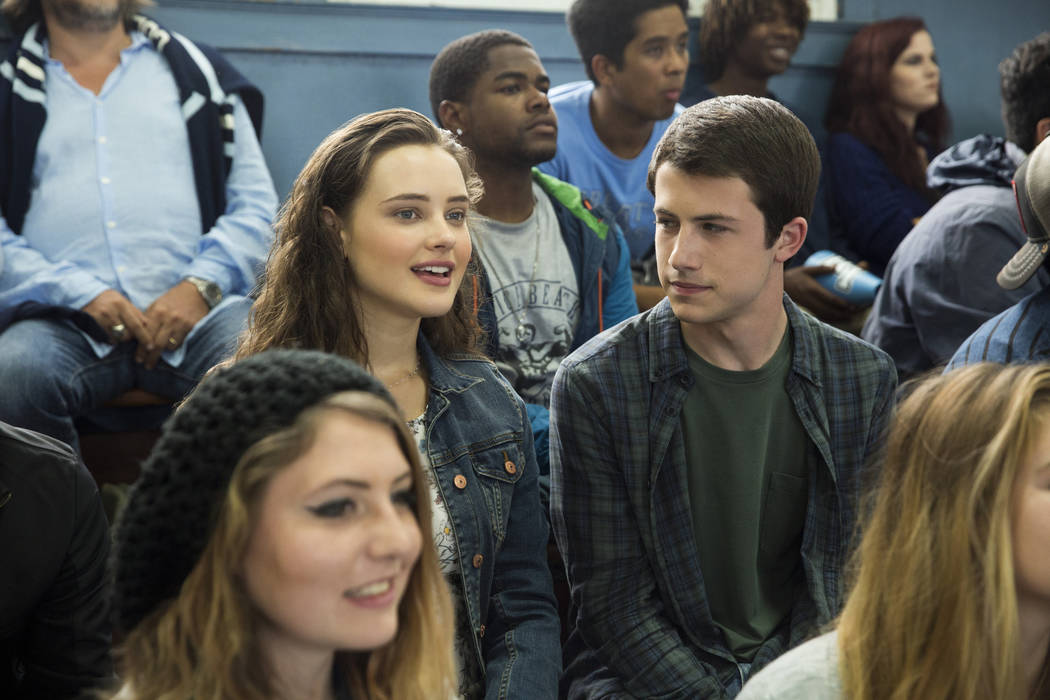 "Hannah Baker (Katherine Langford) and Clay Jensen (Dylan Minnette) attend a basketball game in a scene from Netflix's ""13 Reasons Why."" Beth Dubber/Netflix"