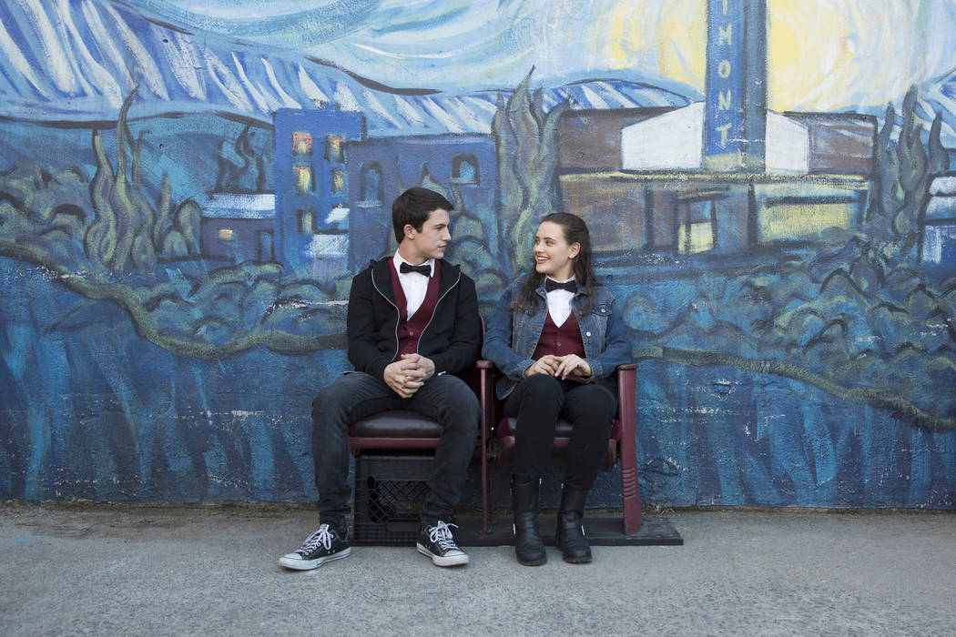 "Clay Jensen (Dylan Minnette) and Hannah Baker (Katherine Langford) take a break from their jobs at the local movie theater during a scene from Netflix's ""13 Reasons Why."" Beth Dubber/Netflix"