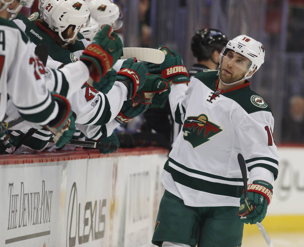 Minnesota Wild left wing Jason Zucker is congratulated as he passes the team box after scoring a goal against the Colorado Avalanche after only 10 seconds elapsed in the first period of an NHL hoc ...