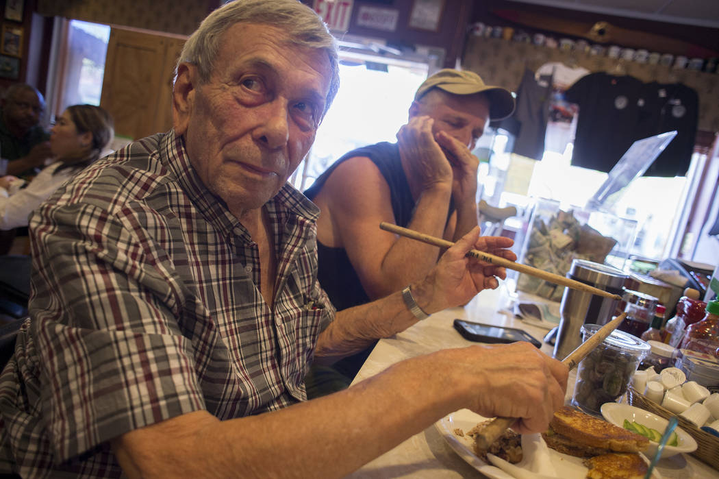 Sandy Nelson, 78, pretends to play the drums while friend David Dilley plays harmonica in the background at The Coffee Cup on Thursday, May 4, 2017, in Boulder City. Nelson, who has been drumming  ...