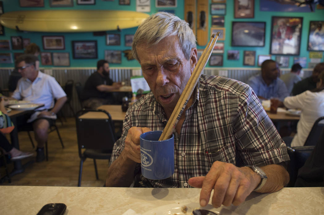 Sandy Nelson, 78, goofs around by placing his drumsticks in his cup of coffee at The Coffee Cup on Thursday, May 4, 2017, in Boulder City. Nelson, one of acts for Dillinger Block Party, goes to Th ...
