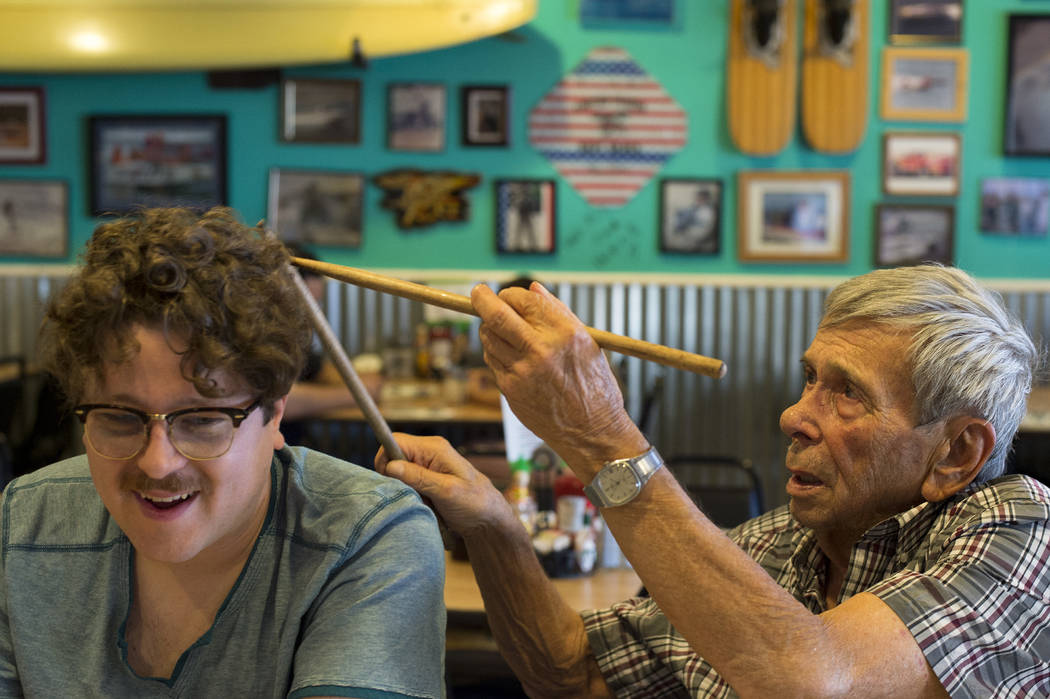 Sandy Nelson, right, drums on the head of friend James Howard Adams, left, at The Coffee Cup on Thursday, May 4, 2017, in Boulder City. Nelson, who has been drumming for decades, is among the acts ...