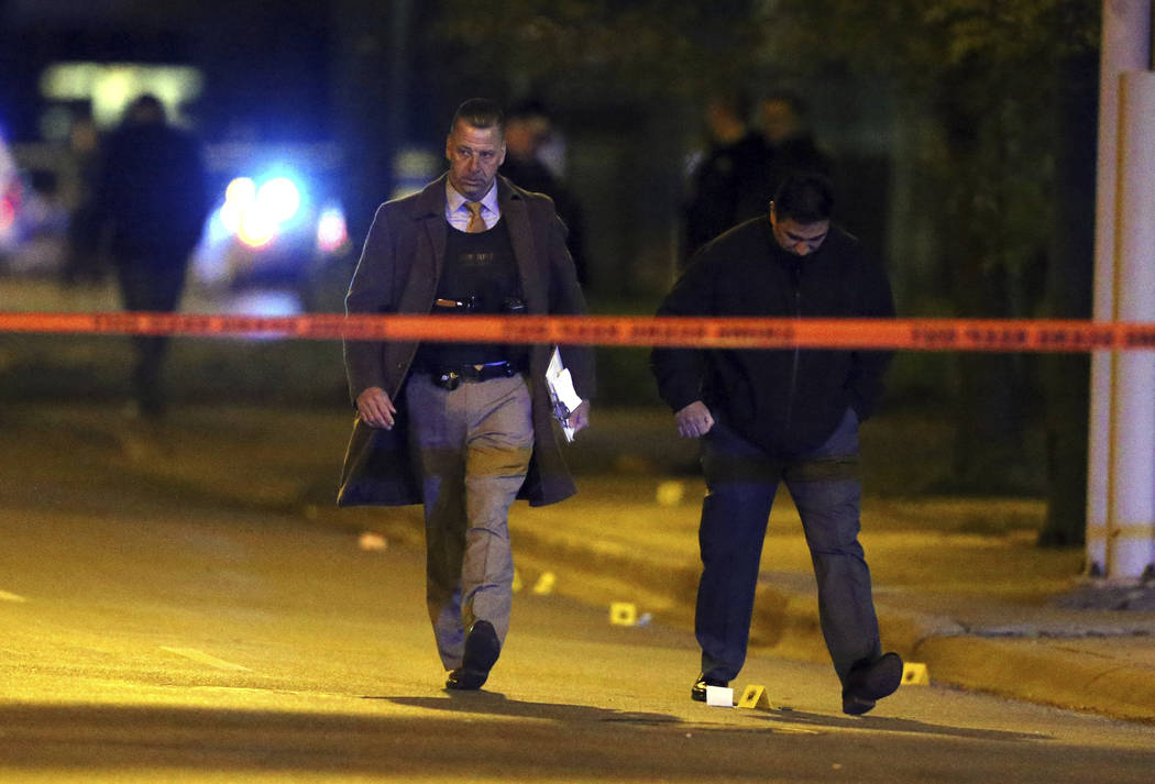 Chicago police investigate the scene where two police officers were shot on South Ashland Avenue in Chicago on Tuesday, May 2, 2017. The officers were shot and wounded late Tuesday during an incid ...