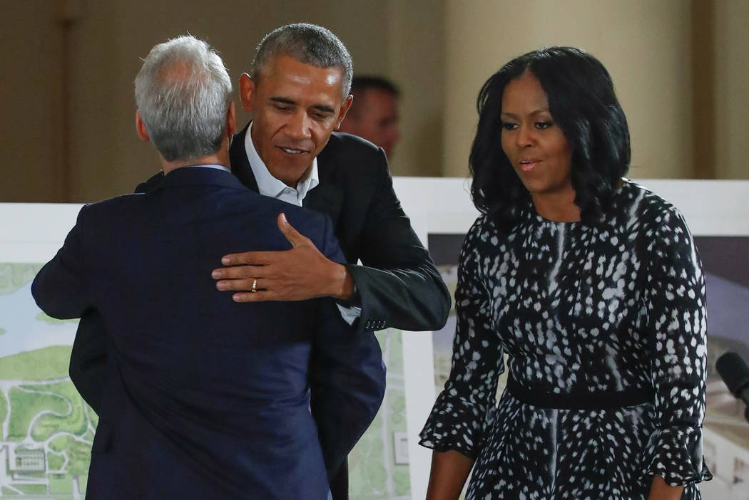 Former U.S. President Barack Obama and former first lady Michelle Obama are greeted by City of Chicago Mayor Rahm Emanuel during a community event on the Obama Presidential Centre at the South Sho ...
