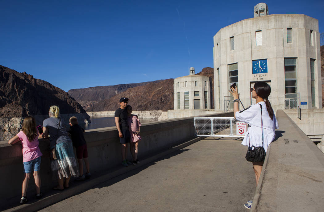 Tourists take pictures at Hoover Dam in Las Vegas on Wednesday, May 3, 2017. Miranda Alam Las Vegas Review-Journal @miranda_alam