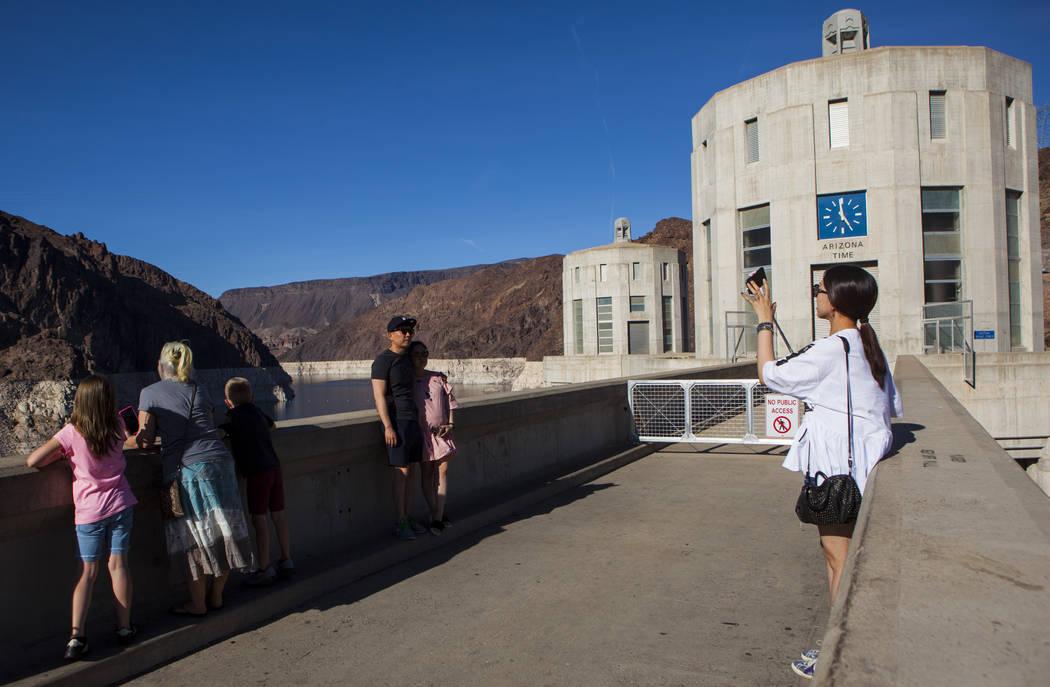 Tourists take pictures at Hoover Dam in Las Vegas on Wednesday, May 3, 2017. Miranda Alam Las Vegas Review-Journal @miranda_alam