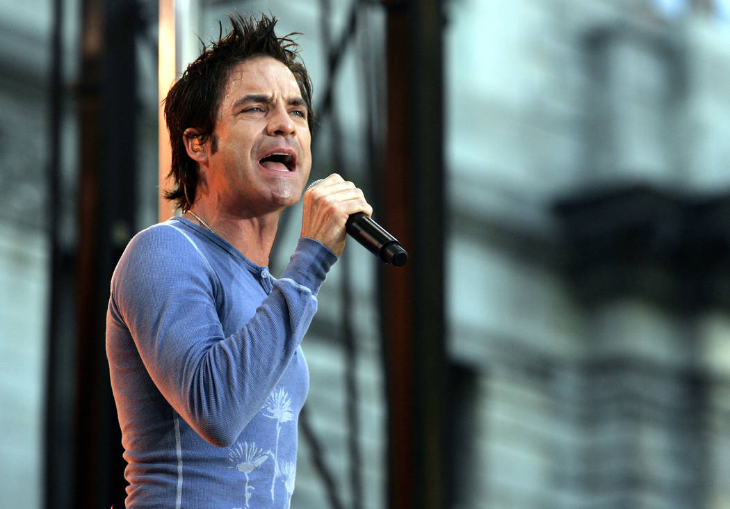 "Singer Pat Monahan of the band ""Train"" performs on stage during ABC's ""Good Morning America"" summer concert series in New York, Friday, July 14, 2006.   (AP Pho ..."