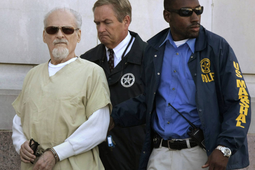 Evangelist Tony Alamo, left, is escorted from the Federal Court House in Texarkana, Ark., after a day of jury deliberations in his trial Thursday, July 23, 2009. (Danny Johnston/AP)