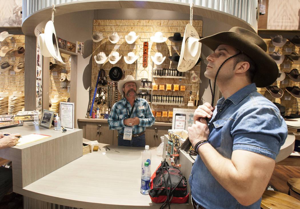 Athanasios Zervas tries on his new hat as Michael Hull looks on at Boot Barn store on Thursday, May 4, 2017, in Las Vegas. Bizuayehu Tesfaye Las Vegas Review-Journal @bizutesfaye