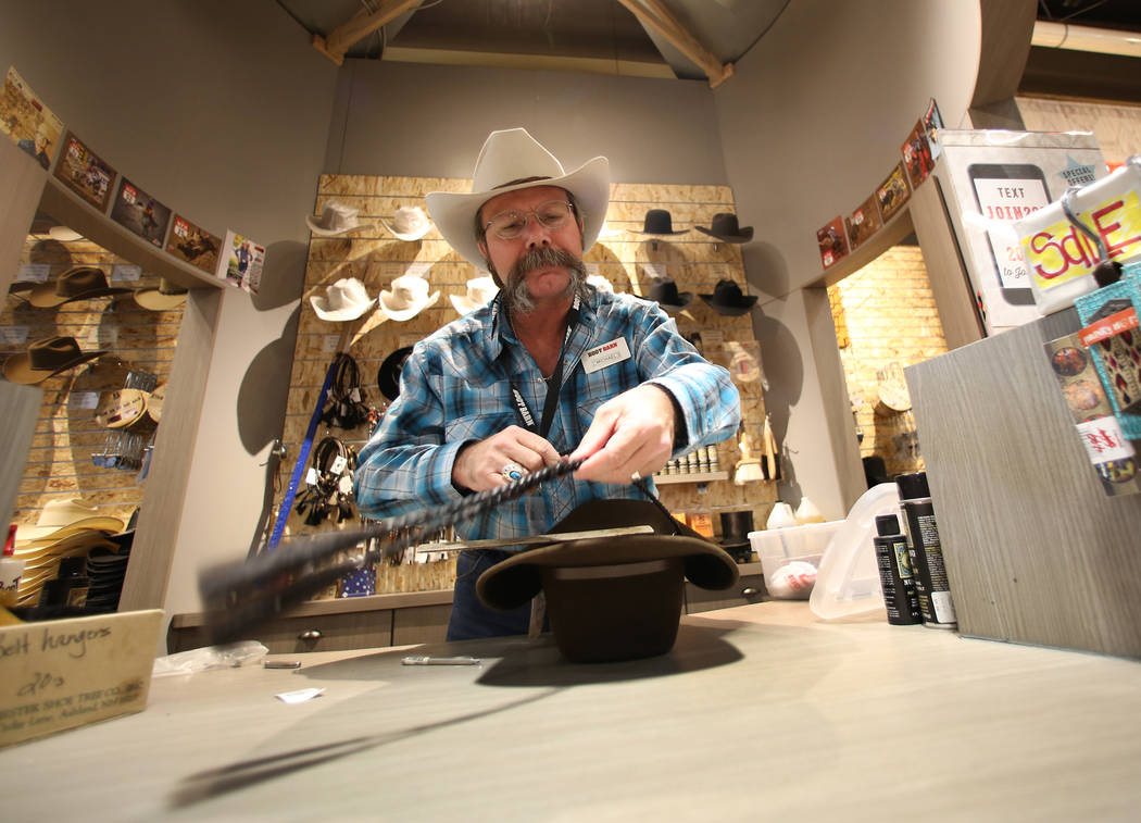 Michael Hull attaches a stampede string to a customer's hat at Boot Barn store on Thursday, May 4, 2017, in Las Vegas. Bizuayehu Tesfaye Las Vegas Review-Journal @bizutesfaye